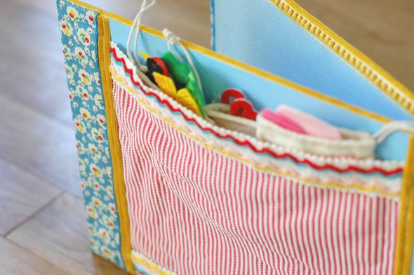 A DIY Felt Board Book with a stretchy pocket at the back to hold all the felt story pieces.