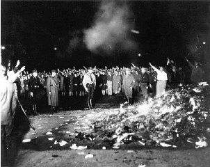 """The book burnings of the Nazi regime was a propaganda plot that that was designed by th Nazi German Student Association, created to burn all books that were considered and 'Action against the Un-German spirit."""" This image shows a scene during the book burning in Berlin's Opera Square. Berlin, Germany, May 10, 1933."""