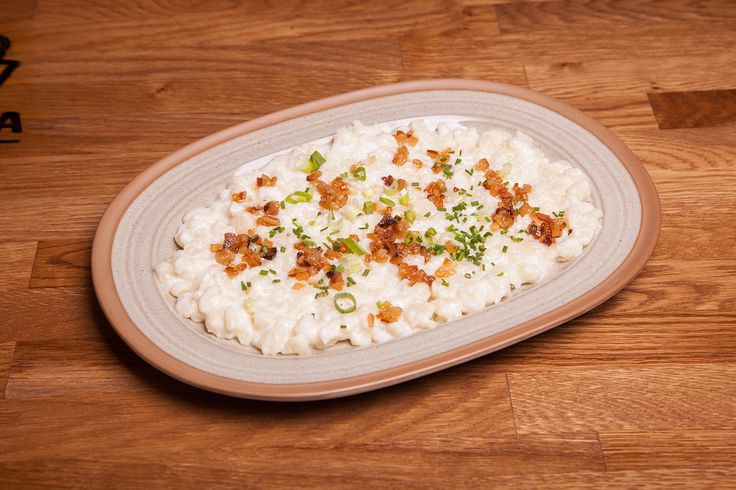 Slovak classic - plate full of traditional Slovak dumplings with Bryndza sheep cheese.