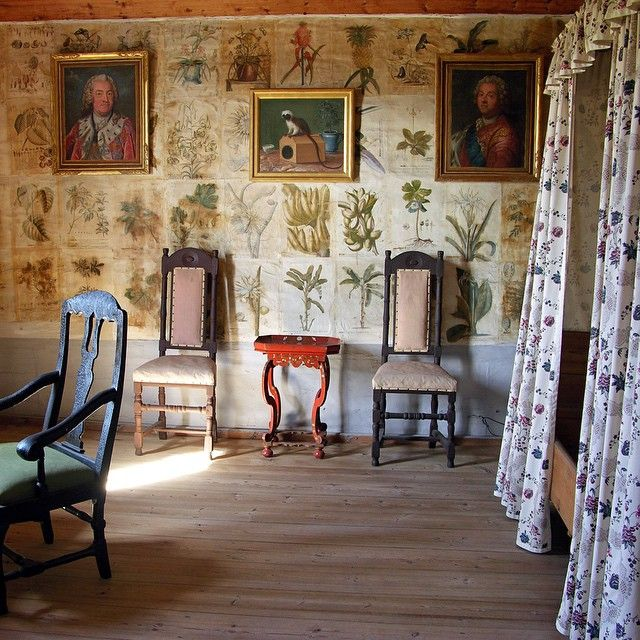 Carl Linnaeus' bedroom at Hammarby. The walls are covered with prints from Dionysis Ehrets Planta Selecta, 1750-73. To the left is a portrait of King Adolph Fredric and to the right of the monkey Grinn is a portrait of Linnaeus' great friend and benefactor Count Carl Gustaf Tessin.