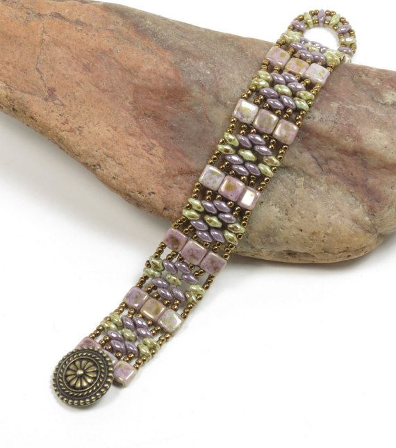 A stunning bracelet featuring Czechmates Tile beads in opaque gold/smoky topaz and Super Duos in both opaque luster amethyst and ultra luster