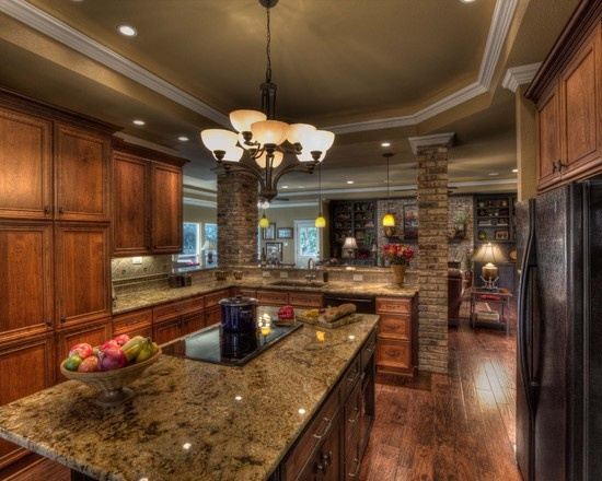 DeWils cabinets, wood floors, granite countertops, breakfast bar, chandelier lighting, stone columns