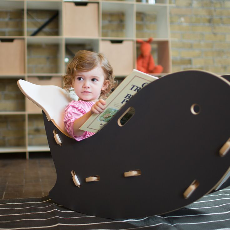 Click now for more super cute kids furniture! Adorable little girl reading in a Grey Whale Kids Rocking Chair by Sprout Kid Furniture --