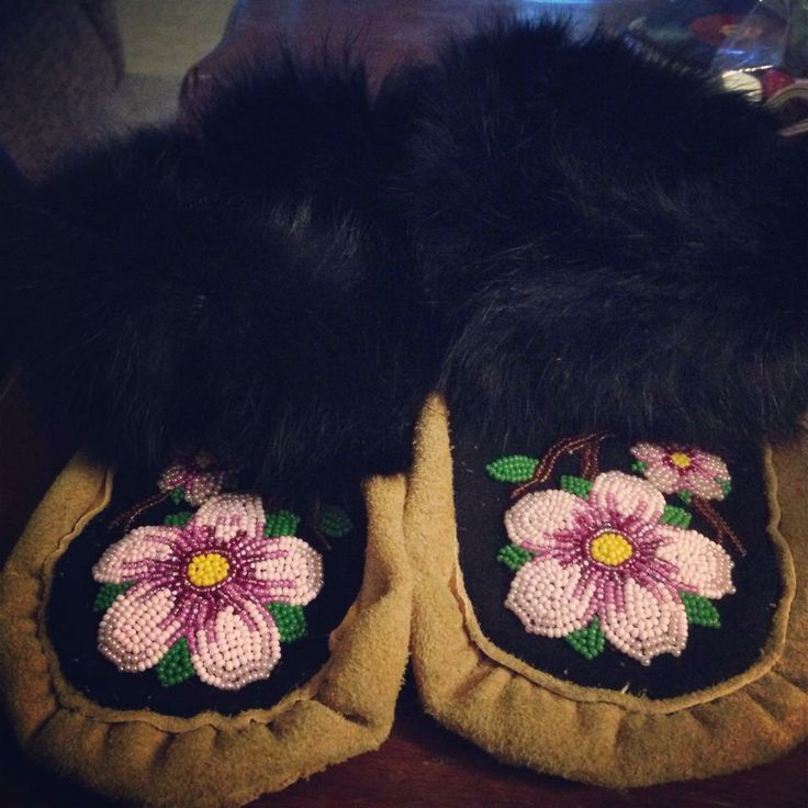 moccasins with cherry blossom beading by Vicki Fraser - 2014. elk skin, moose hide soles, melton wool vamps with seed beads, rabbit fur cuffs