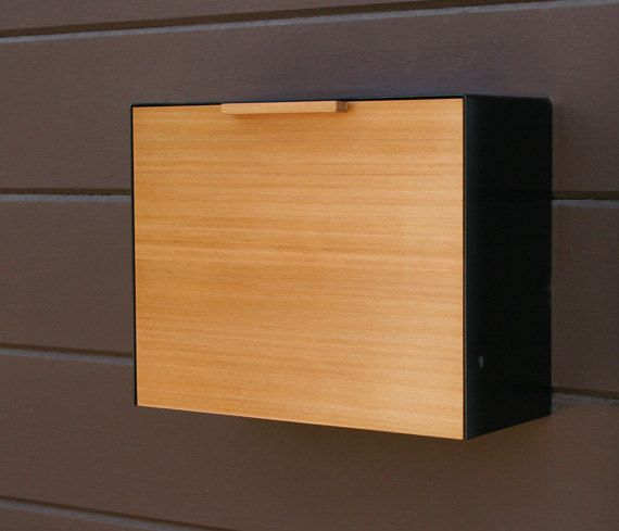 This stainless steel and Cedar mailbox measures 14 5/8W x 11H x 6D and can also be stained to match your existing woodwork. The mailbox is designed