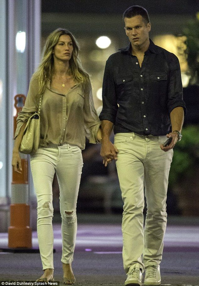 Happy couple? Tom Brady and Gisele Bundchen were spotted hand-in-hand while looking very serious en route to a cinema date on Tuesday night
