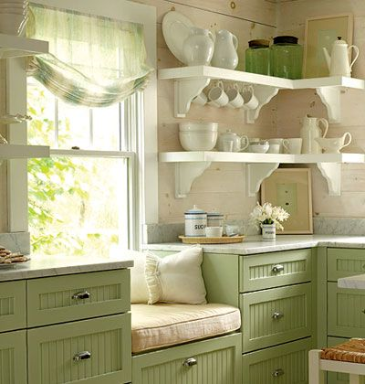 window seat, and green breadboard cabinets