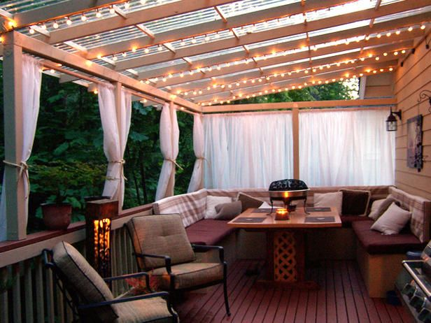 Strings of lights, curtains on curtain rod, outdoor dinning table, dreamy outside patio
