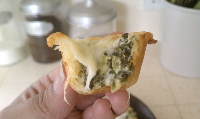 spinach artichoke bites 1 (8 oz.) package softened cream cheese (I used reduced fat) 1/4 cup mayo 1/2 cup grated parmesan or romano cheese 2 cloves garlic, peeled and minced 1 (14 oz.) can artichoke hearts, drained and chopped 1 cup frozen chopped spinach, thawed and drained 2 tubes of crescent roll dough shredded mozzarella