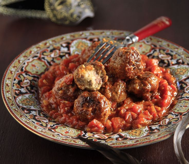 Stuffed Meatballs by greek chef Akis Petretzikis. Delicious pork meatballs stuffed with mozzarella cheese, perfect for any occasion.