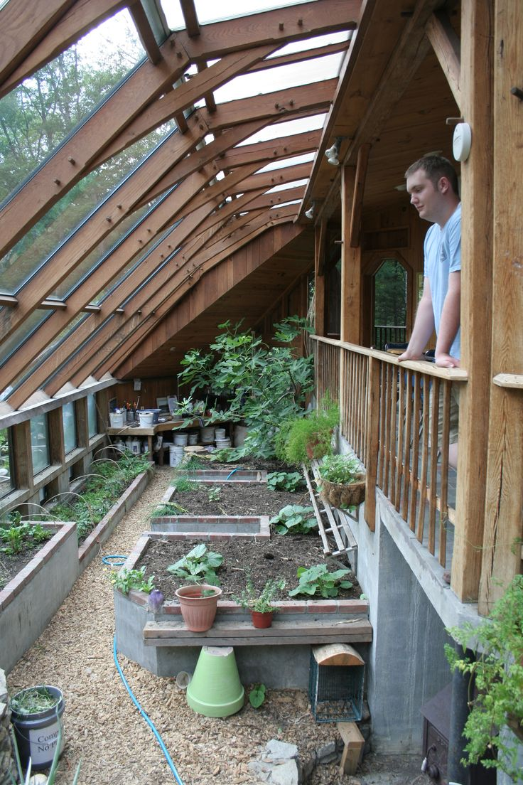 The greenhouse at Sirius Ecovillage uses solar exposure, a shared wall with a house, and thermal mass to stay warm in the winter.