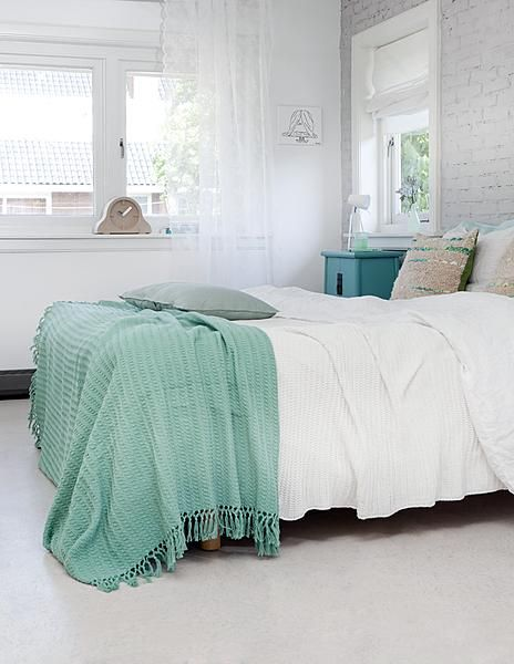 Kim Timmerman - bedrooms - teal throw, teal throw blanket, teal blanket, soft white bedding, sequined pillows, brick wall, brick accent wall...