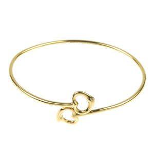 LOT:283   TIFFANY & CO. - a double open heart bangle, by Elsa Peretti for Tiffany & Co