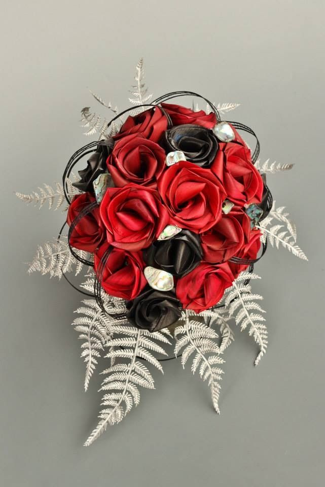 Red and black tear drop bouquet with silver fern and paua pieces.  www.flaxation.co.nz