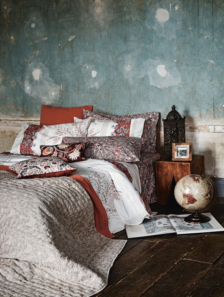 asian inspired bedding pillows wood floor globe bedside table prints tropical bedroom of Glamorously Beautiful Asian Inspired Bedding Designs