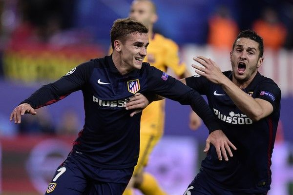 Atletico Madrid's French forward Antoine Griezmann (L) and Atletico Madrid's midfielder Koke celebrate after scoring a goal during the Champions League quarter-final second leg football match Club Atletico de Madrid vs FC Barcelona at the Vicente Calderon stadium in Madrid on April 13, 2016.