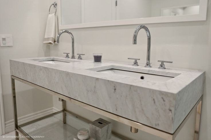 Custom marble vanity for the master bathroom. Hotel chic design