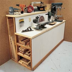 THIS is a brilliant way to store lumber and tools in the same space!  We may be using some version of this in our own garage organization!  And pegboard all along the front, great ideas!