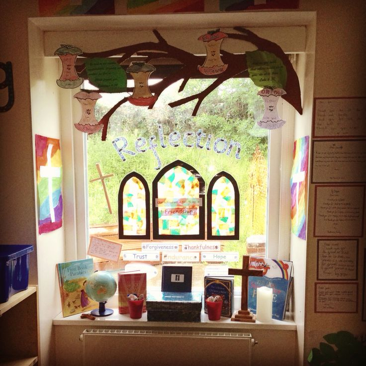 Updated reflection display- Christian values. Children made prayer stones. Branch with Apple - signifying trinity. Bible quotes on leaves to reflect the termly Christian value.
