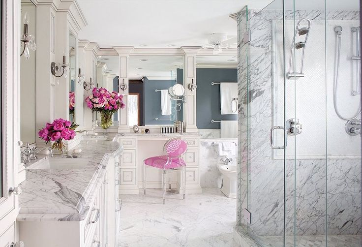Marble Bathroom with Silver Fixtures and Pink Flowers