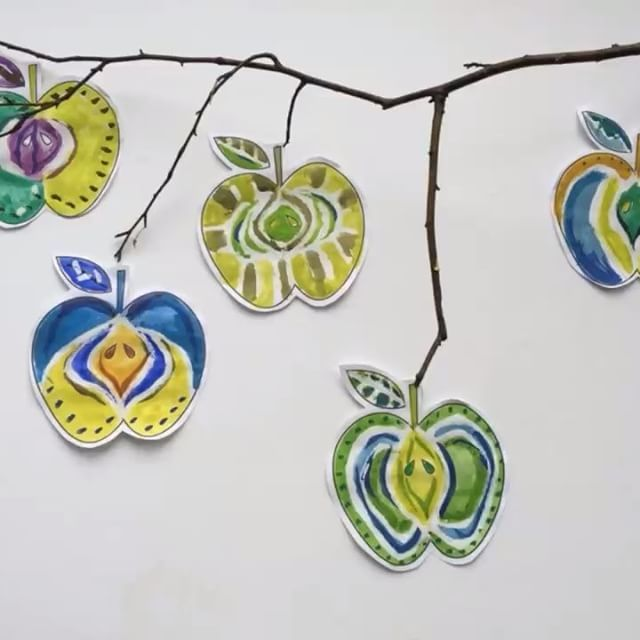 Apples falling from a branch. We used watercolours and wax crayons to decorate them