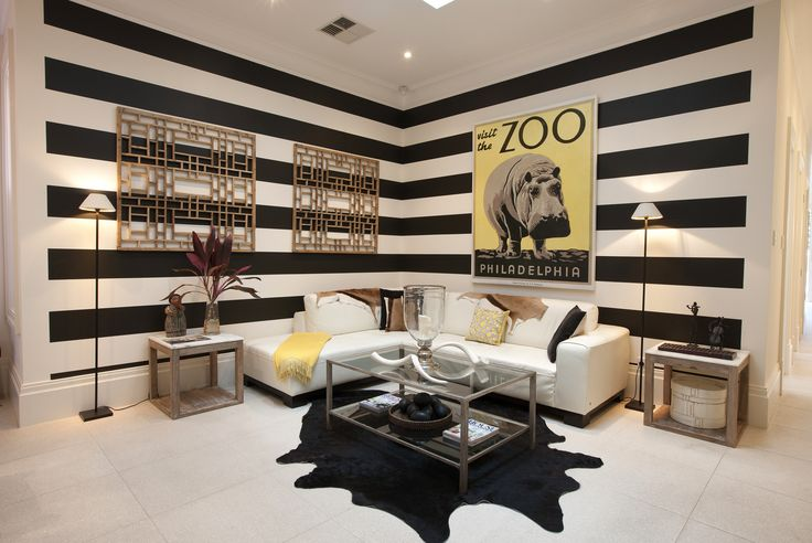 Interior Styling by Josephine Marshall @ one Rundle Trading Co. Living room, black and White feature wall, Philadelphia Zoo framed print, yellow décor, natural hide, oriental wooden screens.