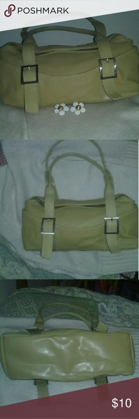 """Kenneth Cole Genuine  Leather Shoulder bag This bag is in good condition and is so cute if you just want something simple yet classy.  It's 14"""" long by 6"""" high so you got some room with this bag. It's got a zip pocket on the inside with two side compartments on the outside. Does have some pen marks on the inside lining but not to many and they are pretty little. Refer to the last photo to see what I mean. Kenneth Cole Bags Shoulder Bags"""