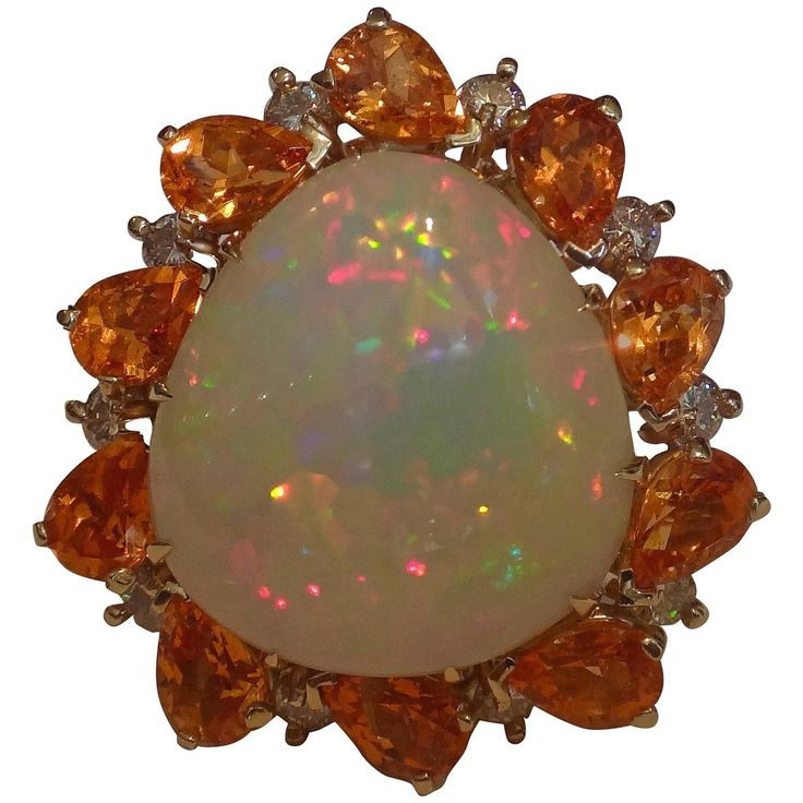 Opal spessartite garnet diamond gold ring | From a unique collection of vintage cocktail rings at https://www.1stdibs.com/jewelry/rings/cocktail-rings/