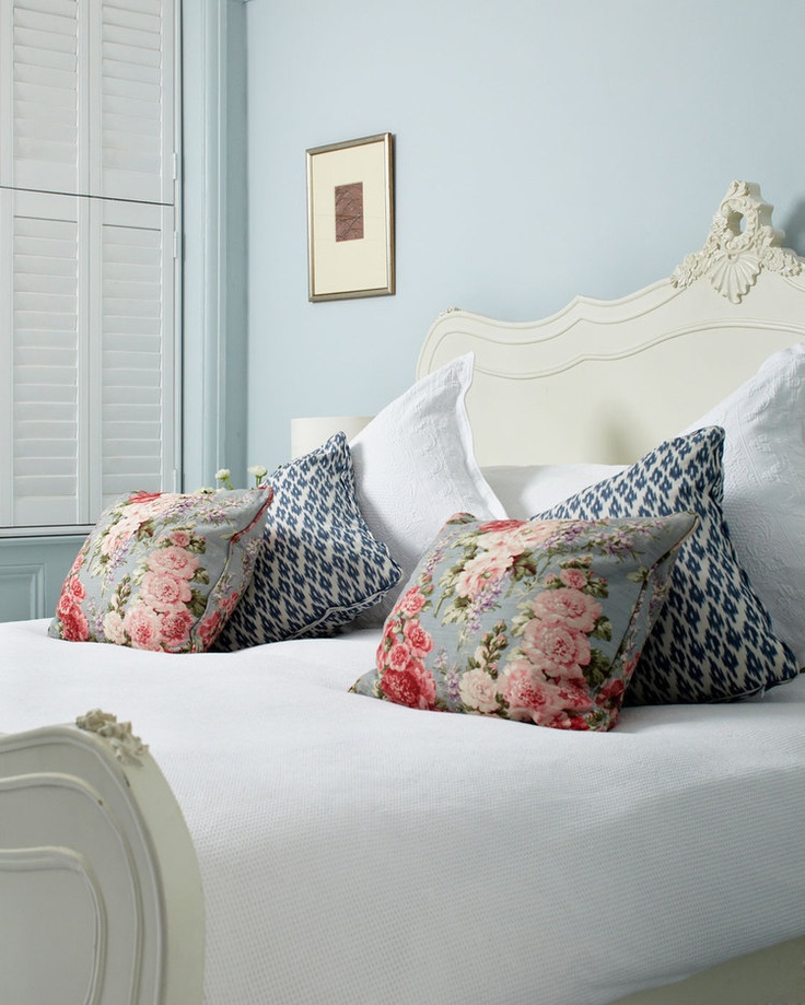 I like the flowered pillows.  A way to add the maroon and green into the bedroom??