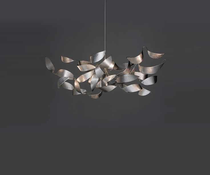 REFLEXION; The Reflexion Suspension Light brings together nature and industry. Reflexion's body is made of stainless steel and features hand shaped aluminum leaves with a subtle texture. These leaves appear as if they are blowing in the wind giving the fixture life and a feel of movement. • TPL LIGHTING • MERGING LIGHTING WITH DESIGN • TPLLIGHTING.COM • TORONTO, CANADA •