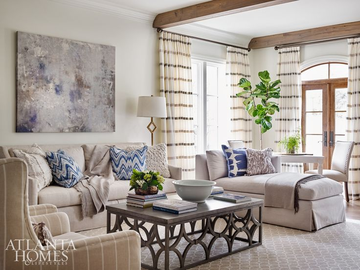 Comfortable and casual reign in the new beamed living room; the Mr. Brown coffee table is an indoor/outdoor piece, while the chaise and game table invite the homeowners and their guests to relax.