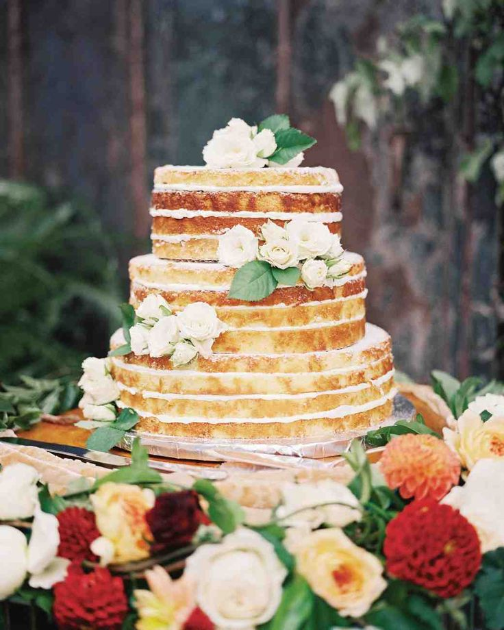 44 Naked Cakes for Your Wedding | Martha Stewart Weddings - A lemon cake—the bride's favorite flavor—with buttercream was decorated with spray roses.