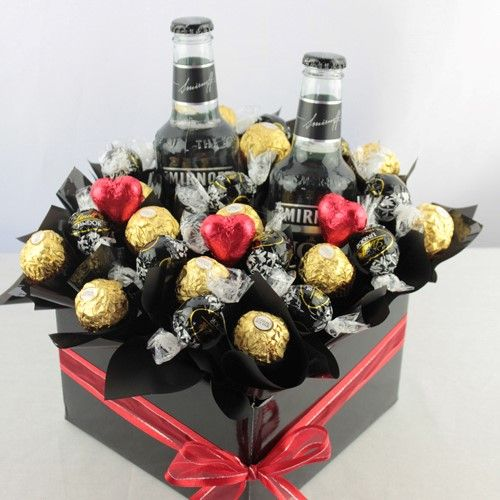 Black Magic Smirnoff is a perfect combination of 2 bottles of Smirnoff Black Vodka , 12 Lindt balls and 12 Ferrero Rocher chocolates. Black Magic Smirnoff comes with a COMPLIMENTARY gift message card. Next day delivery available to most Sydney Metro and Central Coast areas. Overnight delivery available to most Blue Mountains, Newcastle and Wollongong Areas.