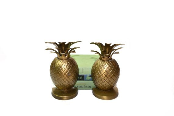 Beautiful pair of large brass pineapple bookends. These brass pineapple bookends would be perfect to go with your tropical or beach décor display on a mantel, bookshelf or your home office. These bookends have material on the bottom so they will not scratch your furniture. D E T A I L S: * Maker: No makers marks  * Measures: 9 Tall X 5 Wide X 3.5 depth  * Condition: Great vintage condition, with a bronze type patina one of the bookends has 2 patina spots on the front of it (see photo #3)…
