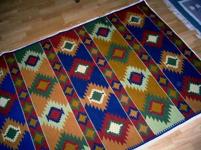 Mi alfombra me demore un año es en punto cruz