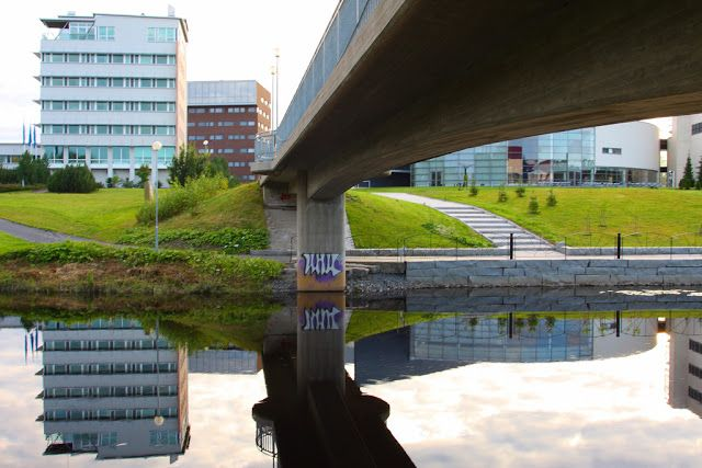 Bridge crossing the river next to the technology center Frami