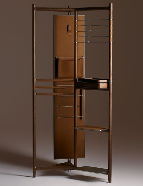 "Hermès Launches a Collection of Exquisite Furnishings Designed by Philippe Nigro The Groom valet is a stunning metal structure covered in Canaletto walnut. Its rotating mirror is backed in leather and equipped with a hook and a pocket, while stainless-steel bars and leather shelving provide additional storage. It measures 36"" w. x 21.5"" d. x 75.5"" h.; $45,100."