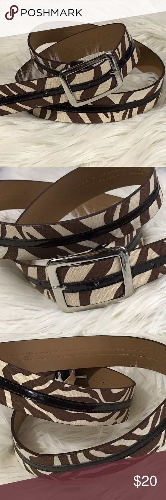 "NWOT Brown Tan Zebra Cloth Faux Leather Belt L New without tags belt, super cute brown & tan zebra print with faux leather trim.   Silver buckle.  Size L.  Total length 42.5"",  length to first notch 35.75"", length to last notch 39.75"". Accessories Belts"