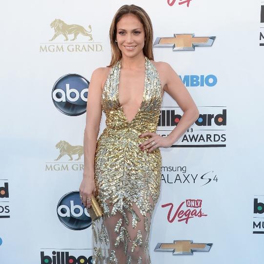 Love it or Leave it? Vote on Jennifer Lopez's glitzy red carpet gown. #billboard
