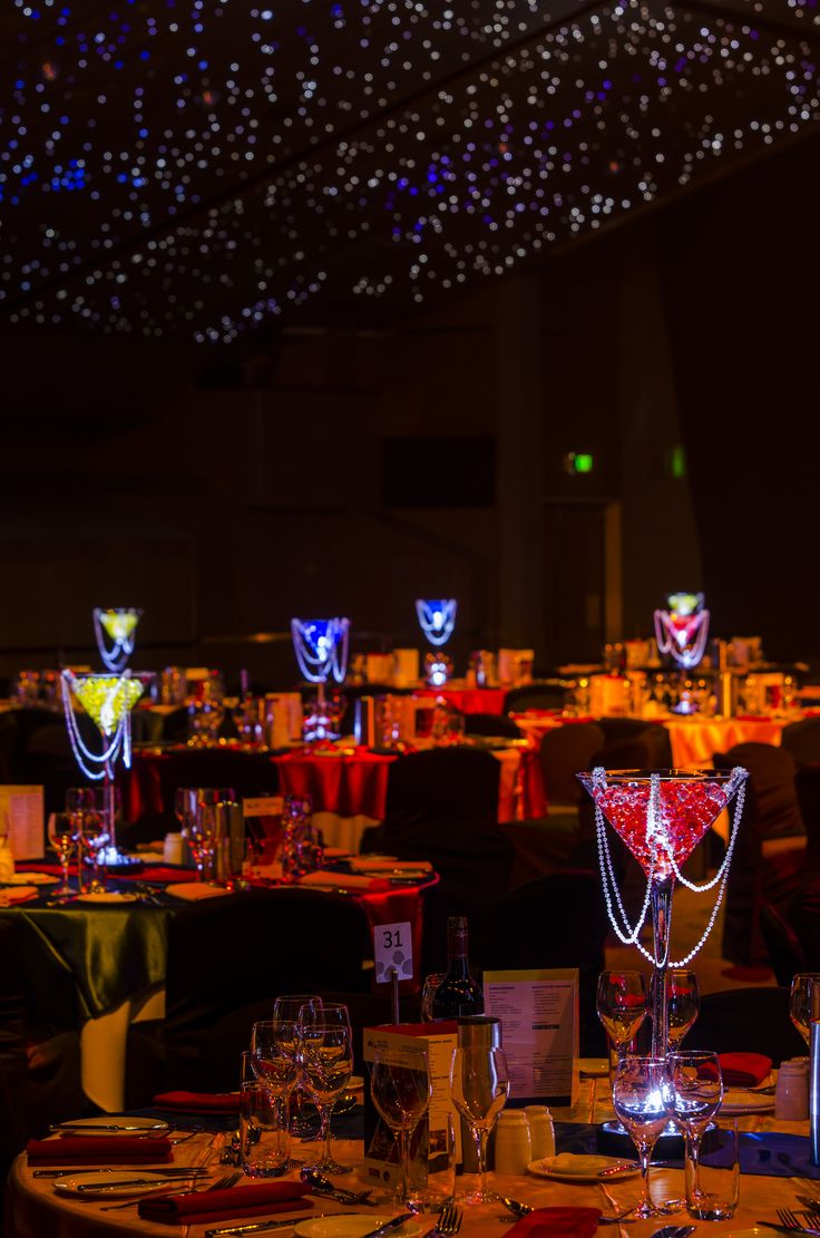 Colourful centrepieces of red, yellow & blue.