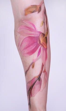I think this is beautiful. It looks like a watercolor painting, but is a tattoo. Placement is perfect for this tattoo too.