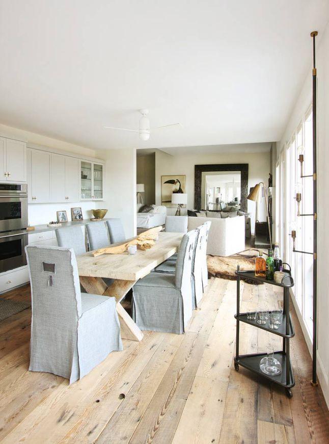 white kitchen, hardwood floor, grey seat covers