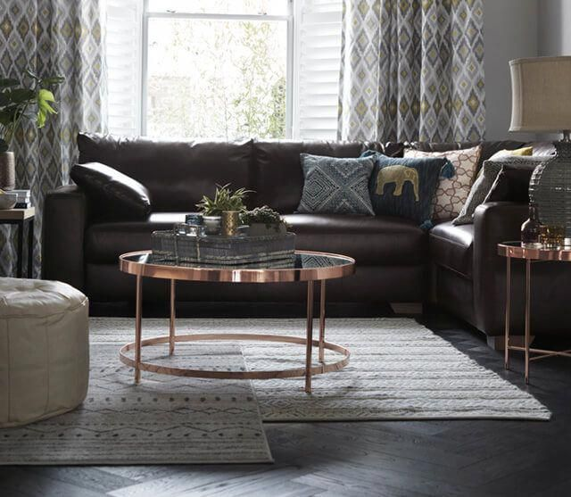 Image Of A Lounge With A Round Copper Table Dark Brown Leather Corner Sofa And Trib Brown Living Room Decor Brown Corner Sofas Brown Leather Sofa Living Room