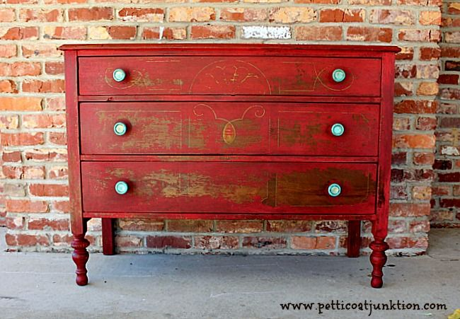 Painted furniture. MMSMP Tricycle Red. I love this color. It's rich and deep and classy. The paint chipped perfectly. Turquoise knobs for contrast. #mmsmp #painted #furniture