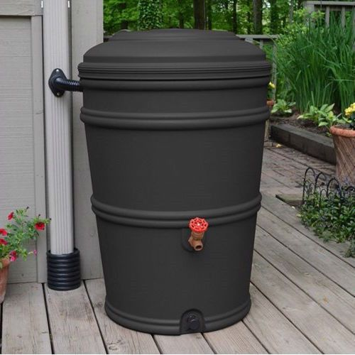 45 gallon rain barrel with spigot and rain gutter water for French drain collection box