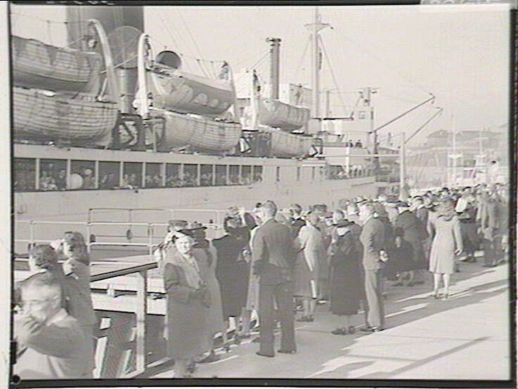 """Arrival of Immigrants on """"Empire Brent"""", 5/1948. Find more detailed information about this photograph: http://www.acmssearch.sl.nsw.gov.au/search/itemDetailPaged.cgi?itemID=216847 From the collection of the State Library of New South Wales: http://www.sl.nsw.gov.au"""
