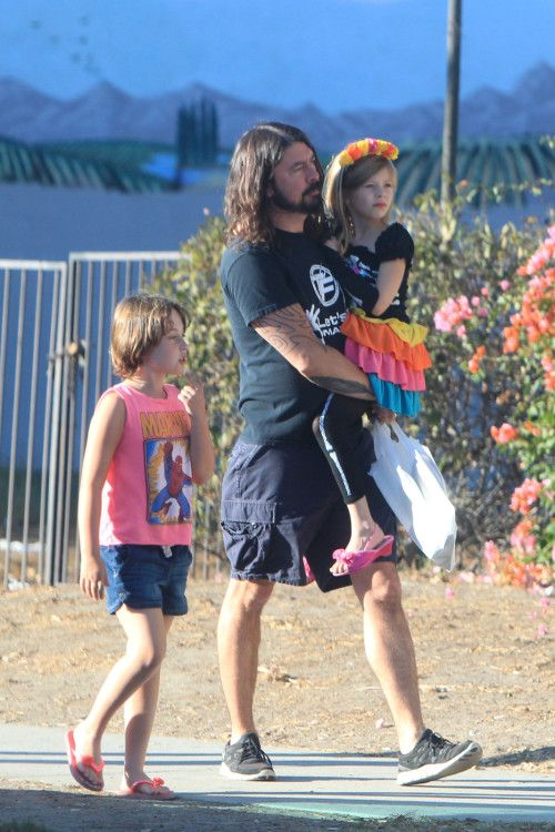 "Dave Grohl and daughters Violet & Harper,. ""I know the beach is around here somewhere!"""