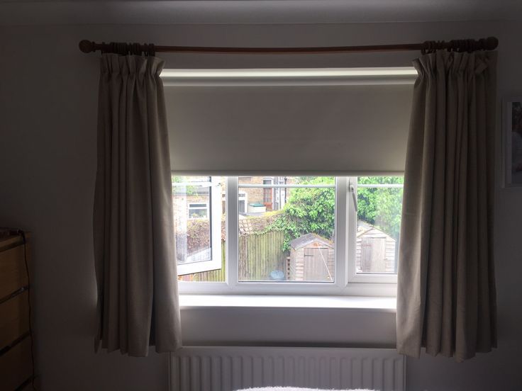 blackout roller blind installed in bedroom where there were existing curtains