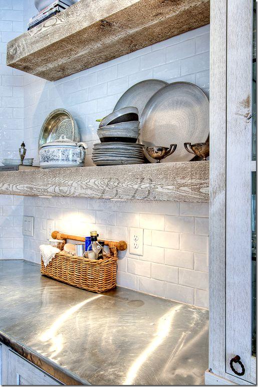 zinc counters, rough wood shelves, white tile backsplash