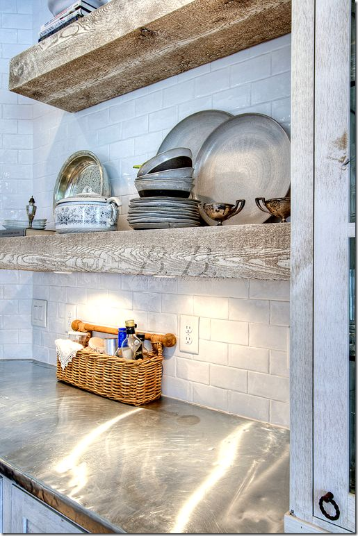 zinc counters, rough wood shelves, white tile backsplash
